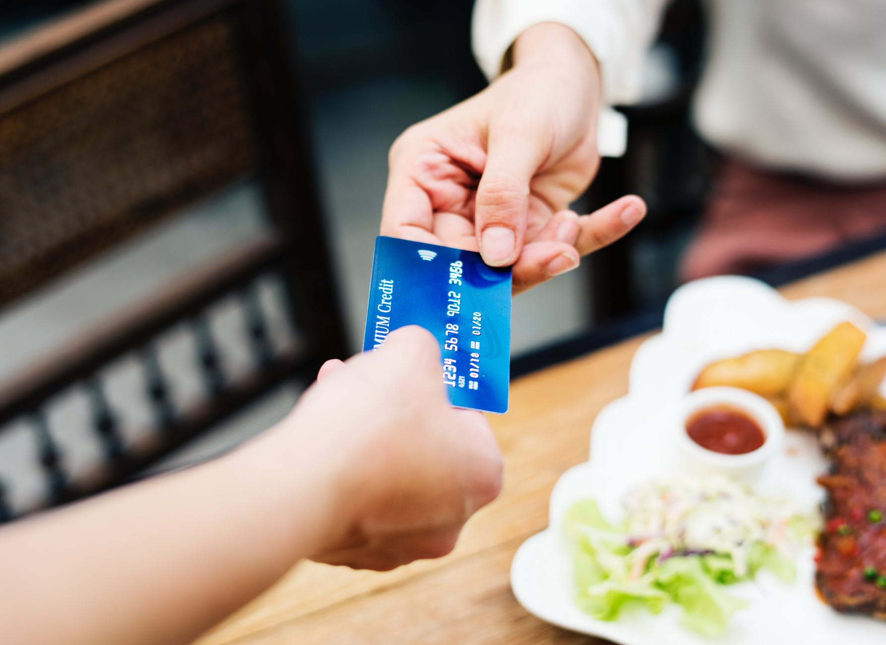 Customer Handing Card to Business Owner Image - Convenience of Card Payments
