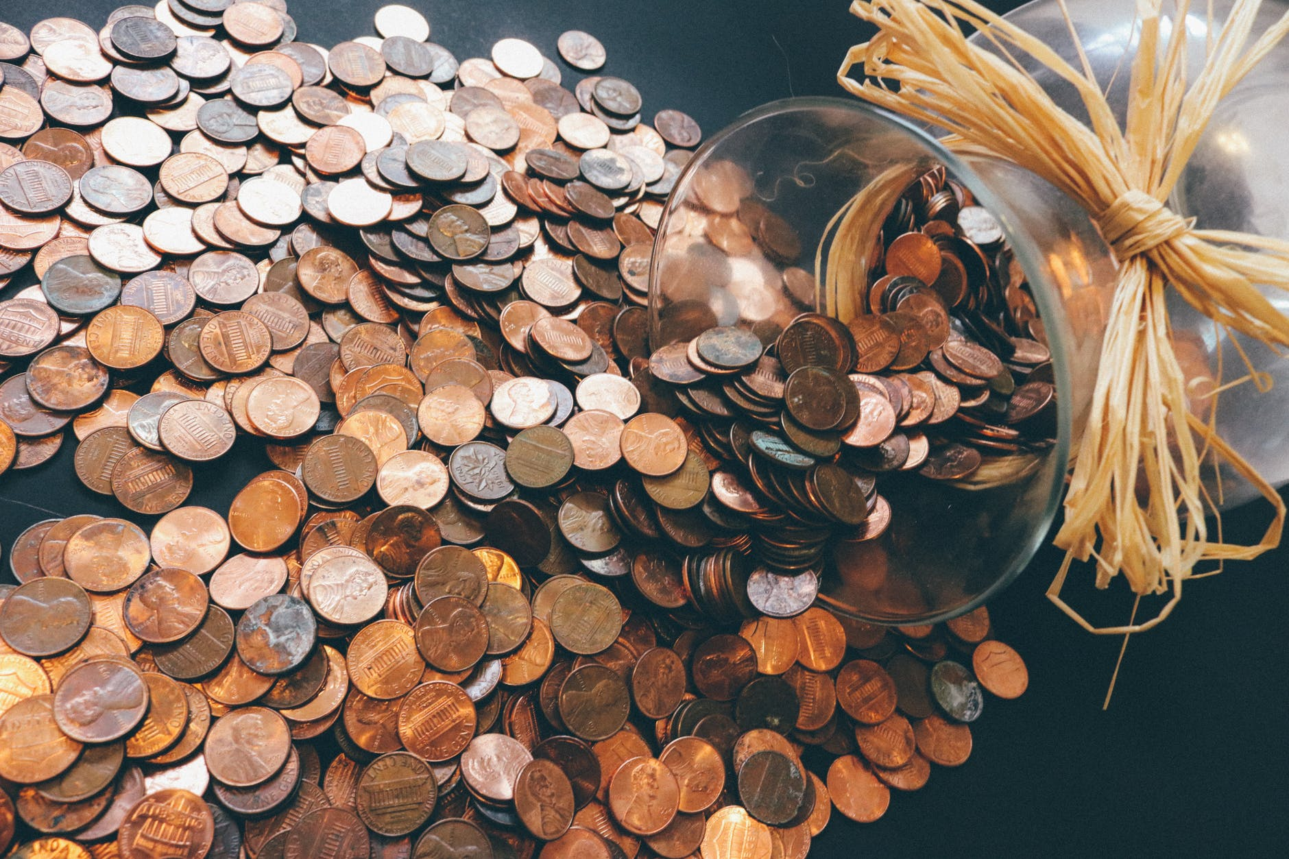 large jar of spilled pennys image - Easy accounting and annual returns with digital payments